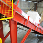 IBC on flighted incline belt conveyor